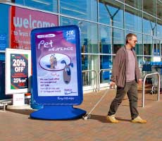 Repositioning or moving the forecourt poster sign